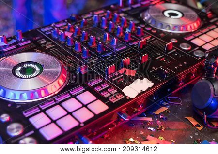 DJ is rhythm music with Controller and mixer.