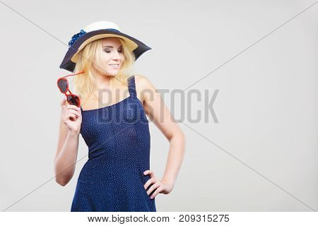 Woman Wearing Short Navy Dress And Sun Hat