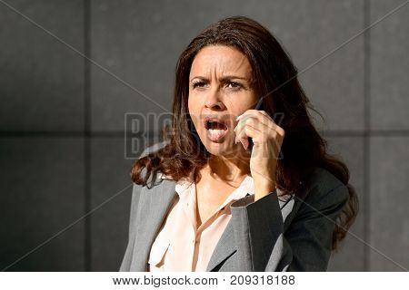 Emotional Woman Speaking On Her Mobile Phone