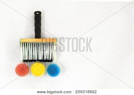 Big paintbrush and blue, yellow and red stains - directly above