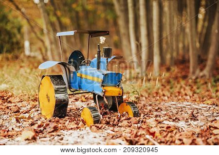 homemade tractor outside. toy car. Copy space for your text
