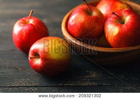 Composition With Red Apples On The Dark Wooden Table