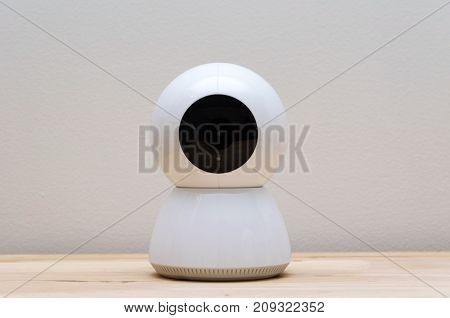 white web camera or webcam on desk with white wall background object internet technology concept