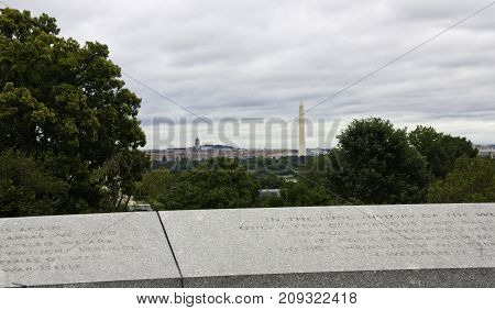 Arlington, Virginia - September 9, 2011 - Wide view from atop a viewing area in Arlington Cemetery with the Washington Monument and Smithsonian Buildings of Washington, DC in the distance, on a bright overcast day in September.