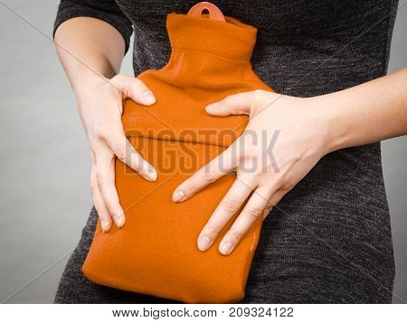 Girl Having Stomach Ache, Holding Hot Water Bottle