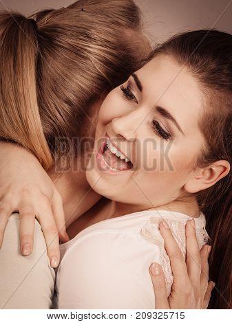 Two Happy Friends Women Hugging