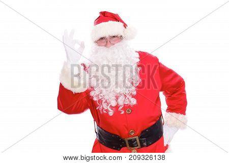 Kind Santa Claus showing ok, isolated on white background.