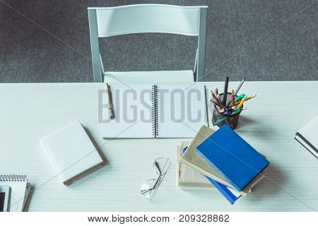 Eyeglasses And Open Notebook On Table