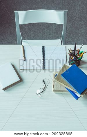 Books And Eyeglasses On Table