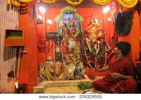 KOLKATA WEST BENGAL INDIA - 13 MAY 2017: Hindu priest worshipping Lord Hanuman known as Hanuman ji in India. Hindu religious persons are praying in front of the idol in the holy temple.