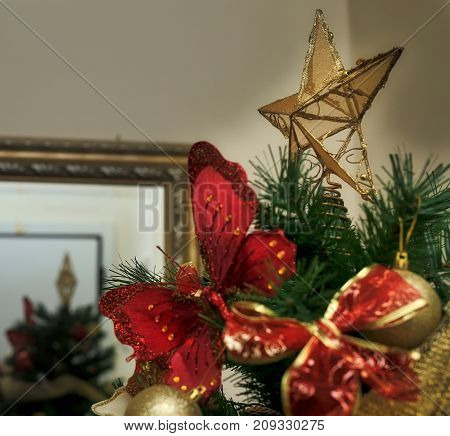 christmas star on tree with decorations to december