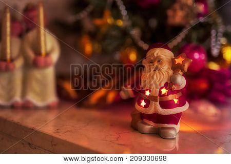 macro santa claus lantern with angels to december