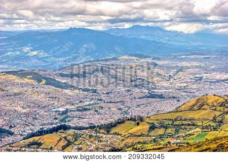 View of the city of Quito and the ecuadorian Andes from the Teleferico touristic attraction, at the top of the Pichincha volcano. Quito, Ecuador.