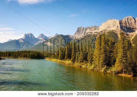 Bow River in Banff National Park near Canmore with Canadian Rocky Mountains in the background, Alberta, Canada.