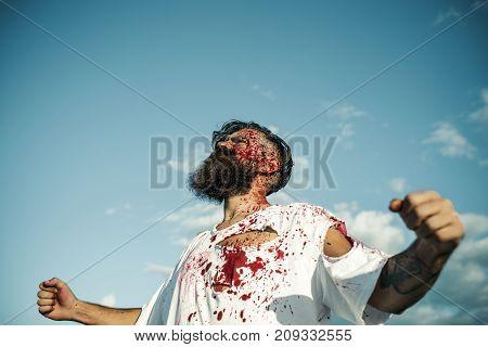 Halloween Man Bleeding Standing With Fists Hands On Blue Sky