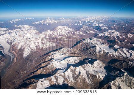 Top view image of the Himalaya mountain and blue sky horizon