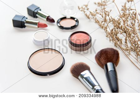 Makeup cosmetics tools background and beauty cosmetics products and facial cosmetics package lipstick eyeshadow on the white background. Lifestyle Concept.