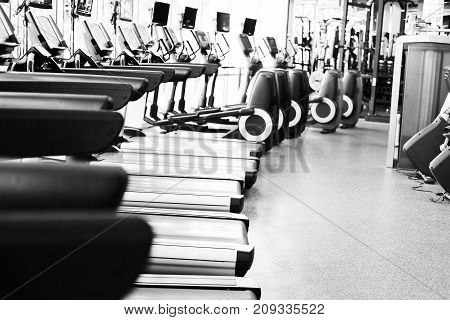 fitness facility center gym interior health club with sports training equipment for aerobic exercise workout and bodybuilding