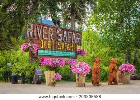 BLUE RIVER, CANADA - JUNE 30, 2017 : Entry sign to Blue River Safari Tours in canadian Rocky Mountains.