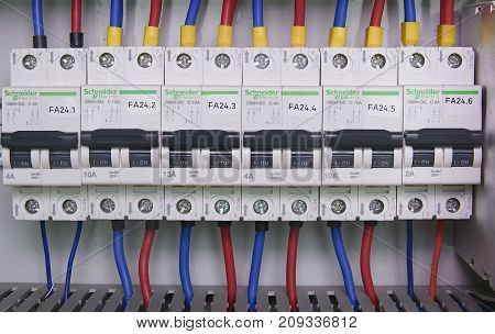 HUSTOPECE, CZECH REPUBLIC - APRIL 10, 2017: Image shows control cubicle. Schneider electric device and Schneider circuit breakers inside power case.
