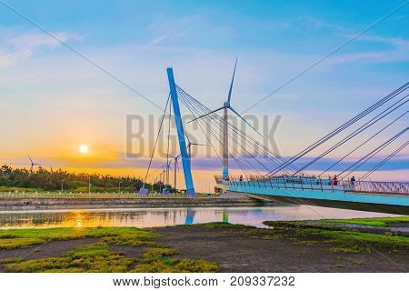 TAICHUNG TAIWAN - JULY 19: This is Gaomei Wetlands a popular tourist destination where many people come to view the sunset on July 19 2017 in Taichung