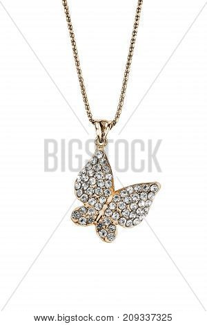 Gold diamond butterfly pendant hanging on a chain on white background