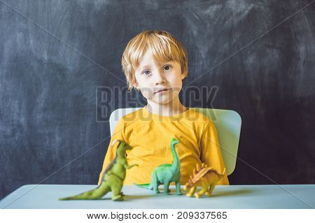 Boy Showing A Dinosaur As A Paleontologist