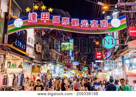 TAICHUNG TAIWAN - JULY 18: This is the main entrance of Fengjia night market the largest night market in Taiwan which is popular with tourits and locals on July 18 2017 in Taichung