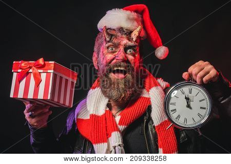 Halloween Or Christmas Man Devil Hold Present Box And Clock