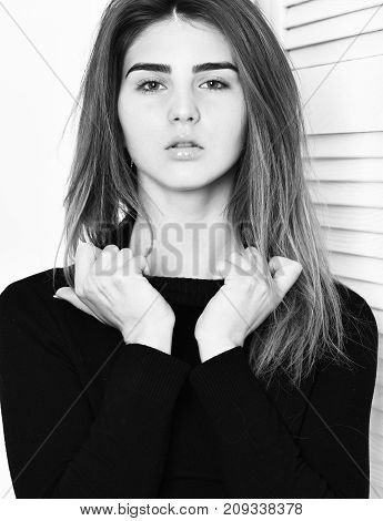Pretty Cute Sexy Caucasian Girl Posing In Black Sweater