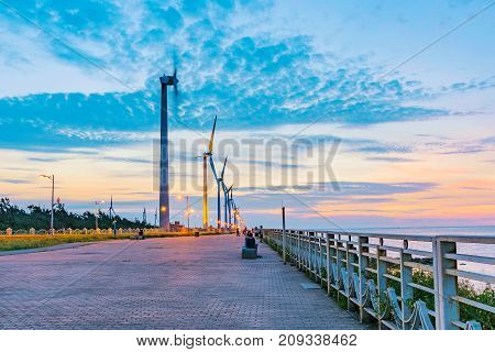 Gaomei Wetlands wind turbines during sunset in Taiwan