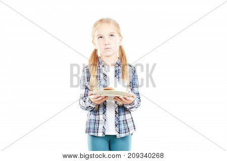 Portrait of beautiful little girl in checked shirt against white background