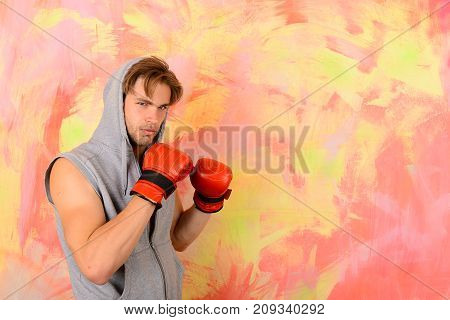 Guy In Grey Sleeveless Hoodie Wears Red Boxing Gloves