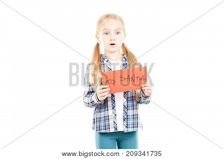 Portrait of little girl holding envelope with letter to Santa