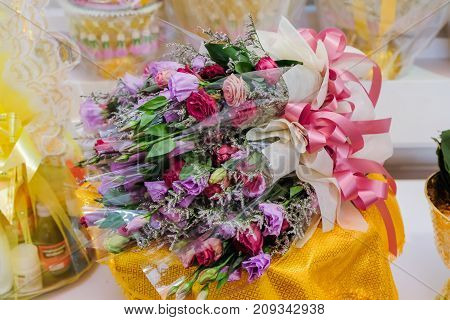 Purple and white orchid flowers are arranged for Buddha worship on Buddhist Holy Day