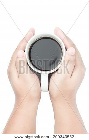 two yellow brown skin tone hands holding white coffee cup on isolated background from top view