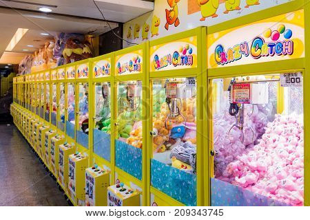 TAIPEI TAIWAN - JULY 11: This is an arcade with crane games where people can win toys which are common across night markets in Taiwan on July 11 2017 in Taipei