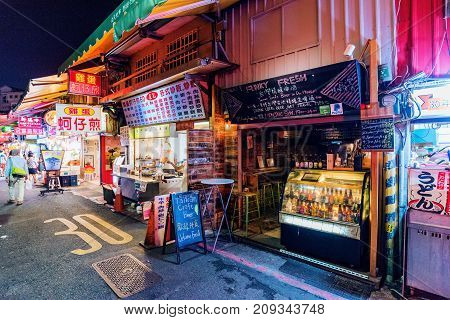 TAIPEI TAIWAN - JULY 11: This is a street in Shilin night market a famous night market where many people come to try Taiwanese food and go shopping on July 11 2017 in Taipei