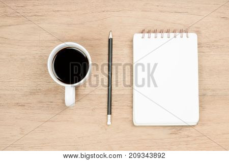 white coffee cup black pencil and opened notebook place on wood texture break time or thinking time concept from top view