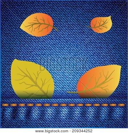 Yellow Autumn Leaves on Blue Jeans Background