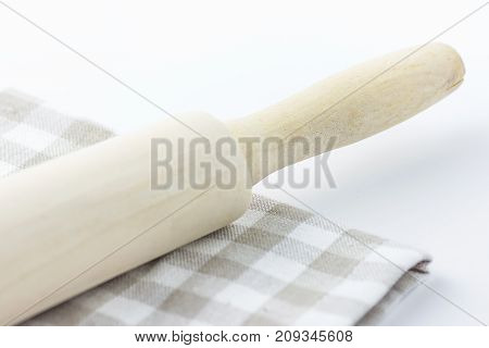 Wood Rolling Pin on White and Beige Chequered Cotton Kitchen Towel. Tabletop. Baking Essentials. Holidays Christmas Easter. Clean Minimalist Style. Copy Space
