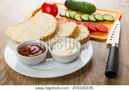 Bread, Sauces In Plate, Tomatoes, Cucumbers On Cutting Board
