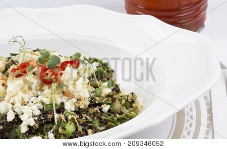 healthy and delicious quinoa salad with feta cheese, tomato, lettuce, red pepper, purslane and oat.