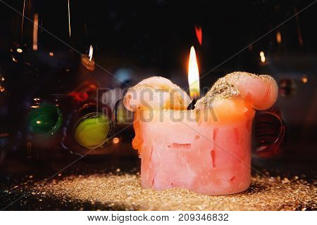 Romantic candle with golden dust on a festive table