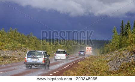 ARCTIC, SWEDEN ON AUGUST 30. View of vehicles, cars on a highway after heavy rain on August 30, 2009 in Arctic, Lapland, Sweden. Forests and rain ahead. Editorial use.