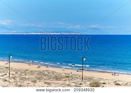La Mata Spain - October 3 2017: People on the beach of La Mata. Torrevieja city. Costa Blanca Province of Alicante. Spain