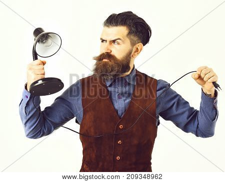 Bearded Man Holding Table-lamp With Serious Face