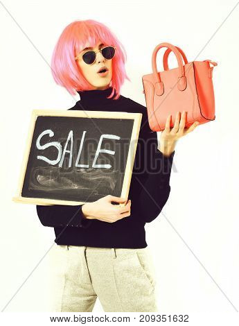 Girl In Wig Holding Bag And Board With Sale Inscription
