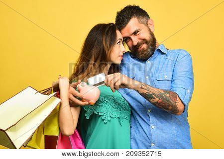 Guy With Beard And Lady With Smiling Faces Do Shopping