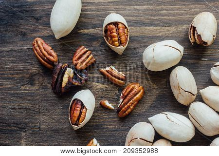 Organic Pecan nuts on brown wooden table